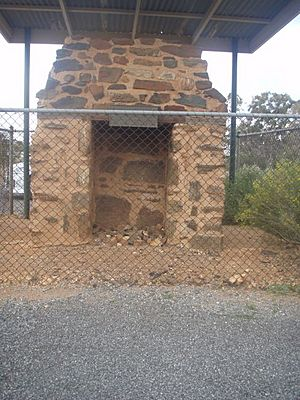 1820 - BHP Chimney Ruin of First Offices - BHP Fireplace with shelter (5061024b3).jpg