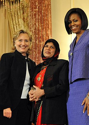 Secretary Clinton With First Lady Michelle Obama and Jansila Majeed of Sri Lanka (130100888) (cropped)