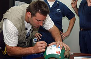 Kurt Warner on USNS Mercy 2-12-05 050212-N-6504N-005