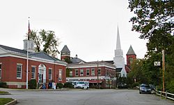 Town center: Plymouth Post Office, Rounds Hall of Plymouth State University (in background), Plymouth Congregational Church, Town Hall (left to right)