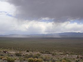 A photo of a storm over the Wah Wah Mountains and Wah Wah Valley