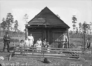 Group of Nine Near Wood Frame Building 1909
