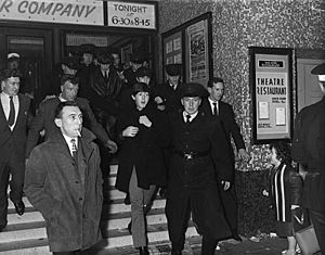 The Beatles emerging from the Ritz Cinema, Fisherwick Place, Belfast November 8, 1963