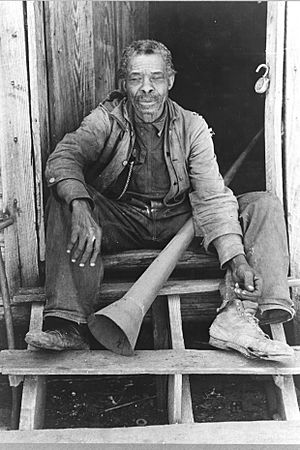 Old Freedman with old slave horn Texas 1939