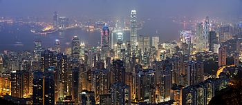 A full scene overlooking the skyscrapers of Hong Kong at night, with Victoria Harbour in the background