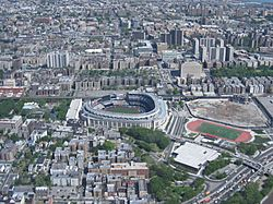 Yankee Stadium (center) and the Grand Concourse to its left. To the right of the Stadium is its former site.
