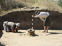 Archaeologists capturing the object