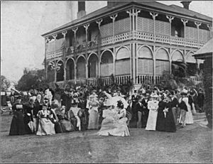 Wedding guests of Miss Perkins and Mr Randall McDonnell in the grounds of Aubigny, at North Quay, Brisbane, 1897
