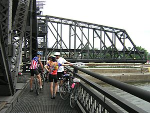 Cyclists on Arsenal Bridge waiting during a bridge opening (2006)