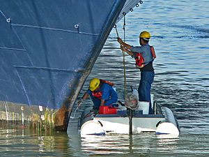 Cleaning the hull 3