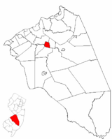 Mount Holly Township highlighted in Burlington County. Inset map: Burlington County highlighted in the State of New Jersey.