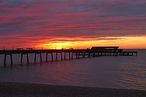 Sunrise over Deal Pier by Dr Alex Kent