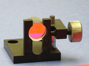 Laserr mirror from a dye laser for use with rhodamine