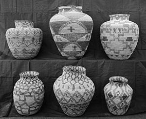 A collection of Apache Indian baskets (ollas) on display, ca.1900 (CHS-3555)