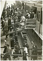 Disembarking South Steyne, Sydney, 1940 - attributed to Dennis Rowe (6184464208)