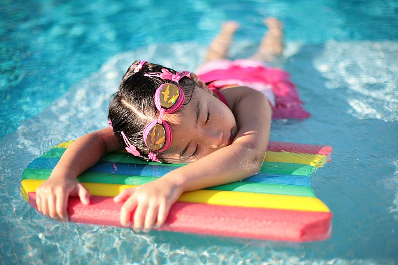 Girl with styrofoam swimming board
