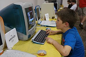 Kid playing on iMac (16728580353)