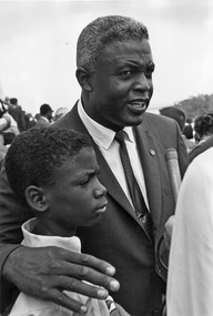 Civil Rights March on Washington, D.C. (Former National Baseball League player, Jackie Robinson with his son.) - NARA - 542024