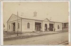 StateLibQld 2 299265 Men standing outside the courthouse in Gympie, 1870