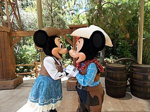 Disneyland Mickey and Minnie kiss as cowboys.jpg