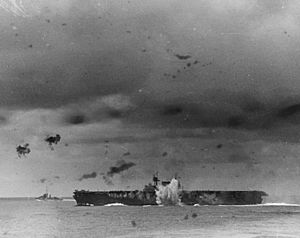 Japanese bomb explodes off the port side of USS Enterprise (CV-6) during the Battle of the Santa Cruz Islands on 26 October 1942 (80-G-30198)