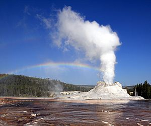 Steam Phase eruption of Castle geyser with double rainbow