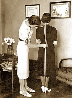 A tailor fitting a customer (Belgrade, 1937)