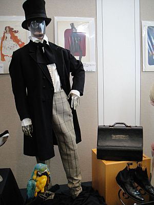 "Debbie Reynolds Auction - Rex Harrison ""Dr John Dolittle"" signature costume with top hat, shoes, prop parrot, and doctor bag from ""Dr Dolittle"""
