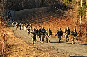 U.S. Soldiers assigned to the 3rd U.S. Infantry Regiment (The Old Guard), conduct a 12-mile road march during Expert Infantryman Badge testing at Fort A.P. Hill, Va., March 22, 2013 130322-A-KF670-299