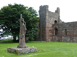 Lindisfarne Priory ruins and St. Aidan statue