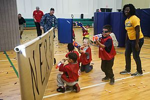 Shoot 'em up, Marines, children duke it out in Nerf battle 150410-M-BQ183-808