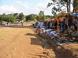 Chipata - roadside clothes vendors.JPG