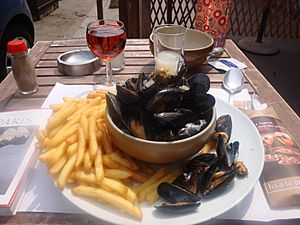 Moules frites wth rose and pastis