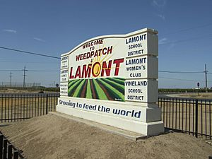 Welcome sign for Weedpatch and Lamont, California, 2012