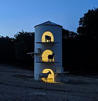 The goat tower at Henly Hills farm in Dripping Springs, TX at night (cropped)