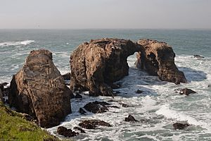 Waterscape with massive arches and stone outcroppings of Miguelito shale, Point Buchon
