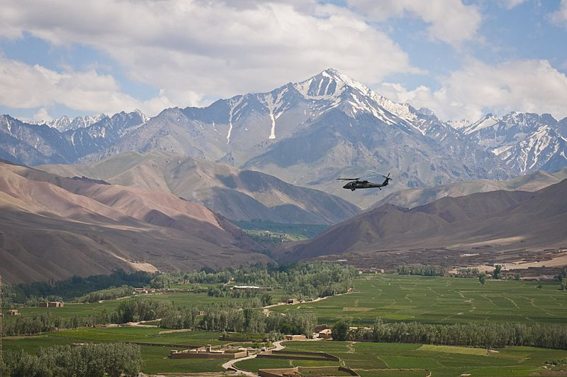 Black Hawk flying over a valley in Bamyan
