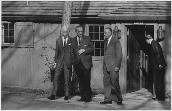 Ambassador Ellsworth Bunker, Ambassador W. Averell Harriman and President Lyndon B. Johnson outside cabin at Camp David - NARA - 192570