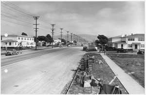 """4,000 Unit Housing Project Progress Photographs March 6,1943 to August 11, 1943, Looking down a street towards the... - NARA - 296755"