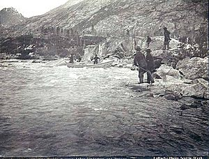 Small boat shooting the rapids on One Mile River between Bennett Lake and Lindeman Lake, British Columbia, 1897 (LAROCHE 301)