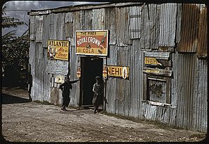 African American migratory workers by a 'juke joint'. Belle Glade, Florida, February 1941