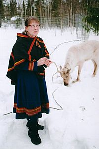 Sami woman with white reindeer