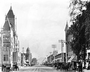 Street view in San Bernardino, California, includes courthouse, ca.1905 (CHS-8547)