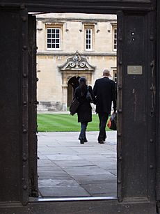 Couple walking into St Johns College Oxford