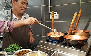 Mixian Rice Noodles Being Prepared in Copper Pots