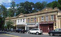 A block of shops on Douglaston Parkway; the National Art League occupies part of this block