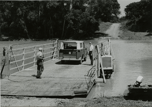 Sharkey County, Miss. June 1, 1965. Sunflower River Ferry is used by Ed Blake and Austin McMurchy on a field trip in the delta