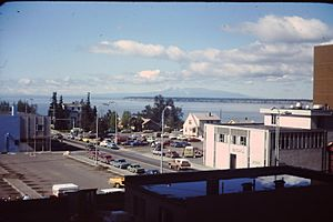 Buildings, cars, bay Anchorage 1976