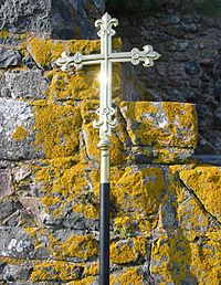 Cross with lichen at Hermitage St Helier Jersey