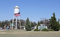 Hartman's welcome sign and water tower.